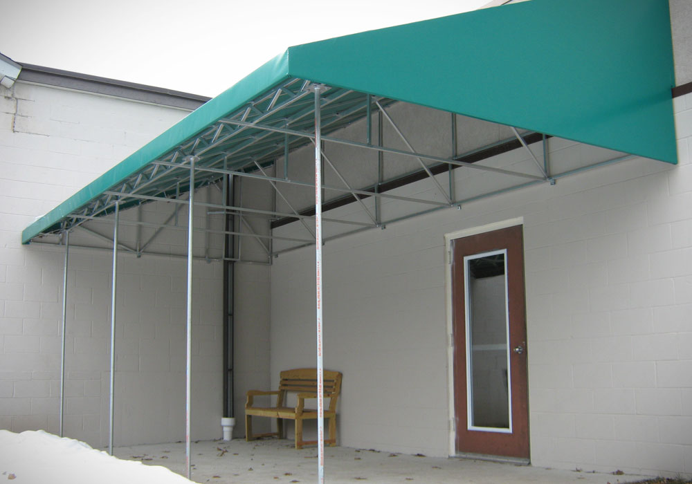 Patio canopies northrop awning company for Balcony awning